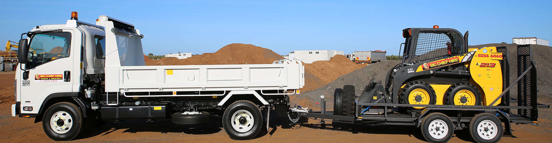 Tipper truck with skid steer on trailer